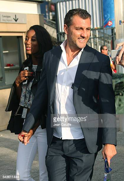 Christian Vieri and his girlfriend model Jazzma Kendrick leave the stadium after attending the UEFA Euro 2016 round of 16 match between Italy and...