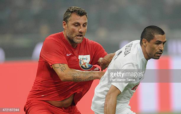 Christian Vieri of Expo team competes for the ball with Ivan Cordobain action during the Zanetti and friends Match for Expo at Stadio Giuseppe Meazza...