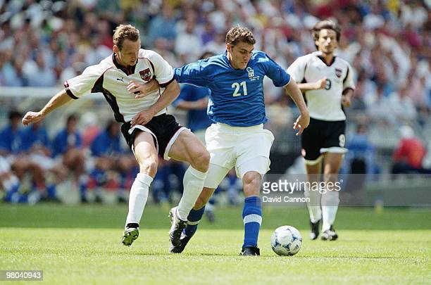 Christian Vieri of Italy holds off the challenge by Anton Pfeffer of Austria during the1998 FIFA World Cup Group B match on 23 June 1998 played at...