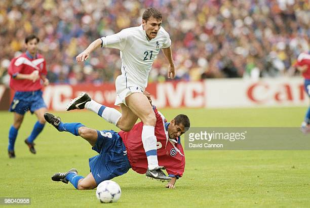 Christian Vieri of Italy jumps over the challenge by Ronald Fuentes of Chile during the1998 FIFA World Cup Group B match on 11 June 1998 played at...