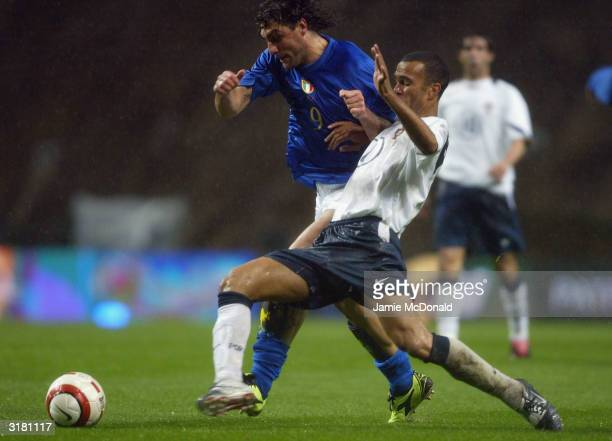 Christian Vieri of Italy slips Costinha of Portugal during an International Friendly match between Portugal and Italy at Braga International Stadium...