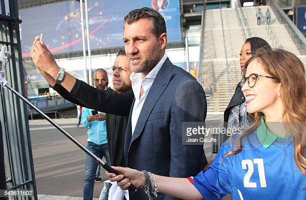 Christian Vieri poses for selfies after attending the UEFA Euro 2016 round of 16 match between Italy and Spain at Stade de France on June 27 2016 in...