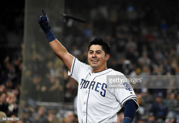 Christian Villanueva of the San Diego Padres comes out of the dugout to wave to the crowd after hitting a threerun home run during the seventh inning...