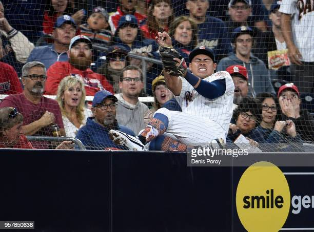 Christian Villanueva of the San Diego Padres crashes into the net as he chases a foul ball hit by Dexter Fowler of the St Louis Cardinals during the...