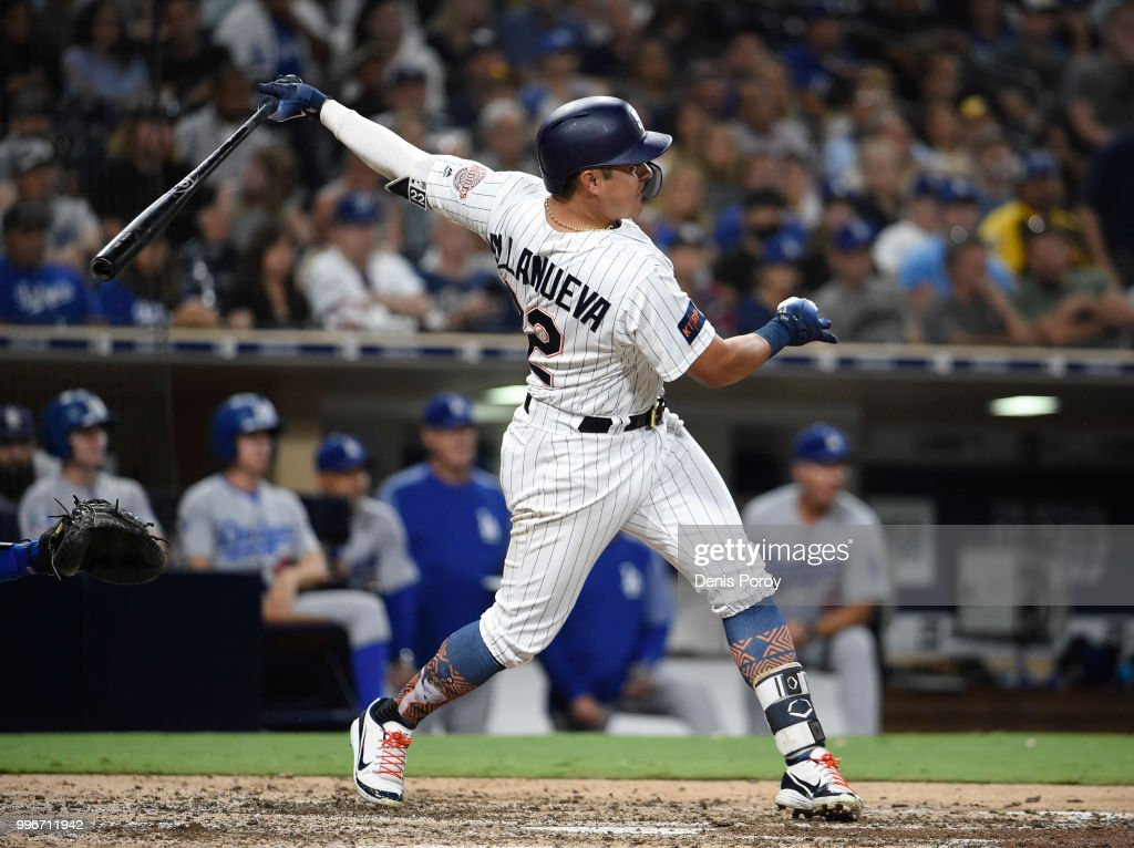 Christian Villanueva #22 of the San Diego Padres hits a solo home run during the seventh inning of a baseball game against the Los Angeles Dodgers at PETCO Park on July 11, 2018 in San Diego, California.