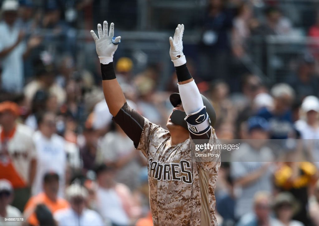 Christian Villanueva #22 of the San Diego Padres looks skyward after hitting a solo home run during the fifth inning of a baseball game against the San Francisco Giants at PETCO Park on April 15, 2018 in San Diego, California. All players are wearing #42 in honor of Jackie Robinson Day.