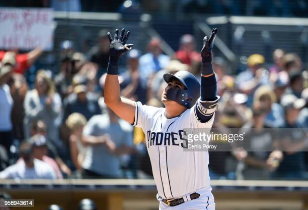 Christian Villanueva of the San Diego Padres points skyward after hitting a tworun home run during the sixth inning of a baseball game against the...