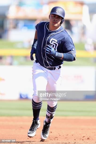 Christian Villanueva of the San Diego Padres rounds the bases after hitting a solo home run during the second inning of the spring training game...