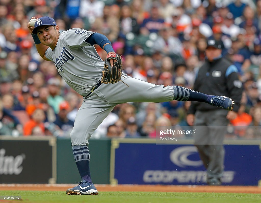 Christian Villanueva #22 of the San Diego Padres throws out Max Stassi #12 of the Houston Astros in the seventh inning at Minute Maid Park on April 8, 2018 in Houston, Texas.
