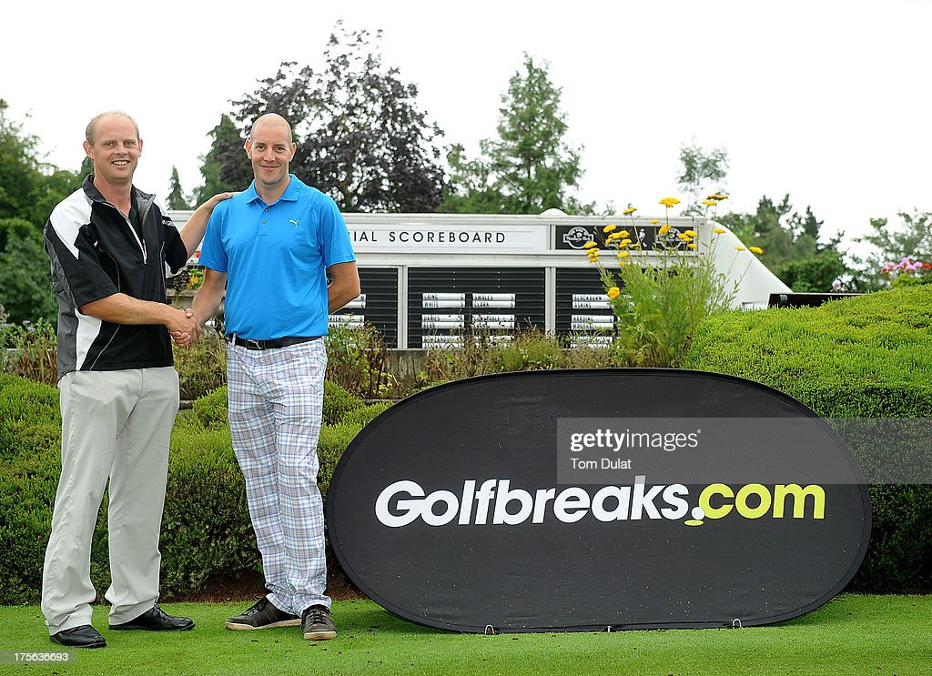 Christian Vine of Woodbury Park & Hotel Golf Club (L) and Kevin Harper of Sidmouth Golf Club (R) pose for photos during the Golfbreaks.com PGA Fourball Regional Qualifier at Exeter Golf and Country Club on August 5, 2013 in Exeter, England.
