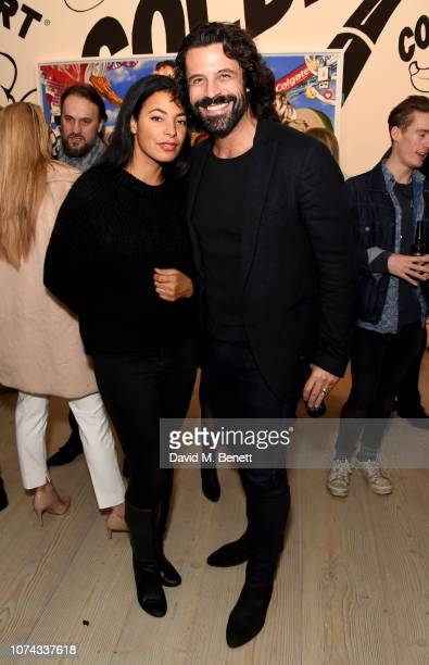 Christian Vit and guest attend the Philip Colbert Hunt Paintings private view presented by Unit London at Saatchi Gallery on December 17 2018 in...