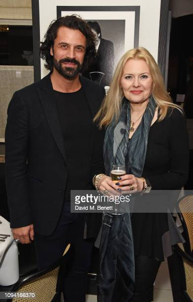 Christian Vit and Susie Howard attend the launch of John Swannell's photography exhibition at Le Caprice on February 5 2019 in London England