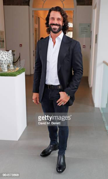 Christian Vit attends the Mouna Rebeiz private view of The Trashc Or Trash in the face of beauty at Saatchi Gallery at Saatchi Gallery on May 31 2018...