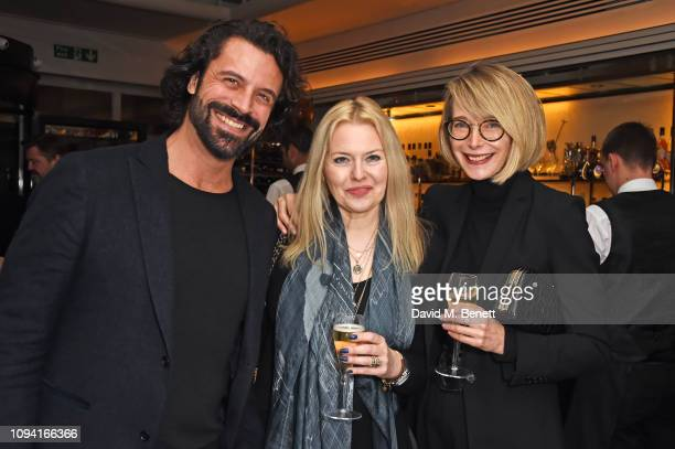 Christian Vit Susie Howard and Marianne Swannell attend the launch of John Swannell's photography exhibition at Le Caprice on February 5 2019 in...