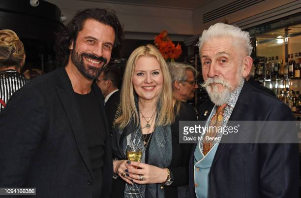 Christian Vit Susie Howard and Sir Roy Strong attend the launch of John Swannell's photography exhibition at Le Caprice on February 5 2019 in London...