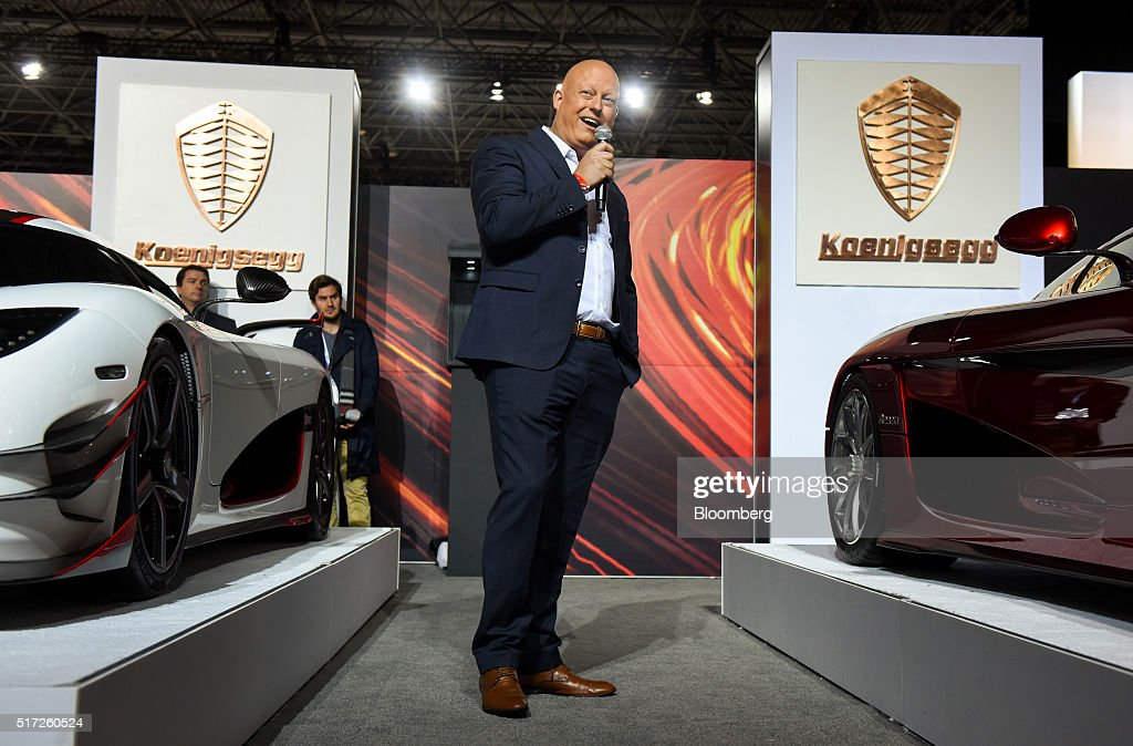 Christian von Koenigsegg, founder of Koenigsegg Automotive AB, speaks while standing next to the Regera luxury vehicle, right, during the 2016 New York International Auto Show in New York, U.S., on Thursday, March 24, 2016. Koenigsegg showed its $2 million Regera 'hypercar' for the first time ever in the United States. Photographer: Ron Antonelli/Bloomberg via Getty Images