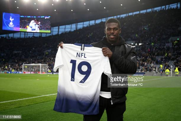 Christian Wade A Running back for the Buffalo Bills poses for with a shirt prior to the UEFA Champions League Quarter Final first leg match between...