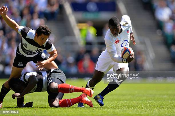Christian Wade of England makes a break enroute to scoring his team's fourth try during the rugby union international match between England and The...