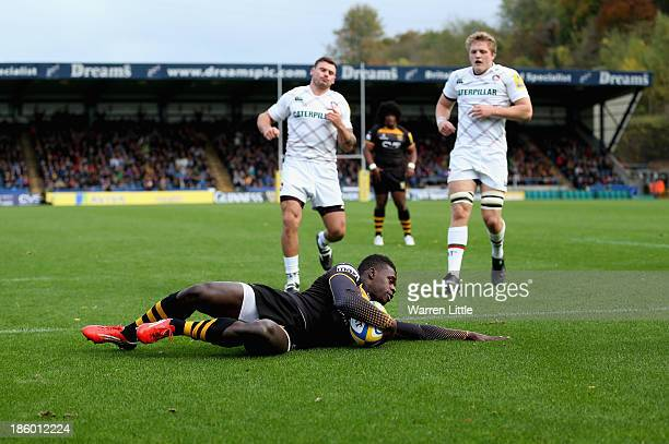 Christian Wade of London Wasps dives over to score the opening try during the Aviva Premiership match between London Wasps and Leicester Tigers at...