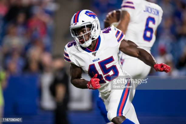 Christian Wade of the Buffalo Bills runs in the back field during the fourth quarter of a preseason game against the Indianapolis Colts at New Era...