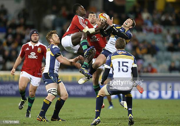 Christian Wade of the Lions competes for the ball in the air with Ian Prior of the Brumbies during the International tour match between the ACT...