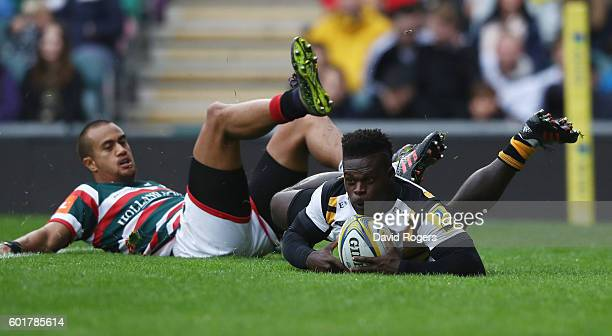 Christian Wade of Wasps beats Peter Betham to the ball to score the first try of the match during the Aviva Premiership match between Leicester...