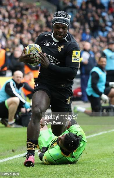 Christian Wade of Wasps breaks clear to score his second try during the Aviva Premiership match between Wasps and Northampton Saints at The Ricoh...