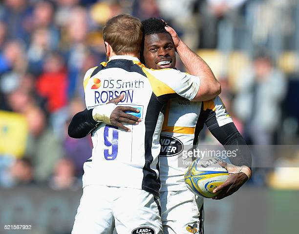Christian Wade of Wasps celebrates scoring his fourth try of the match with Dan Robson during the Aviva Premiership match between Worcester Warriors...