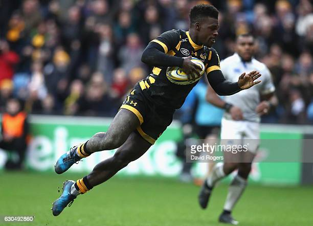 Christian Wade of Wasps dives over for his third try during the Aviva Premiership match between Wasps and Bath Rugby at The Ricoh Arena on December...