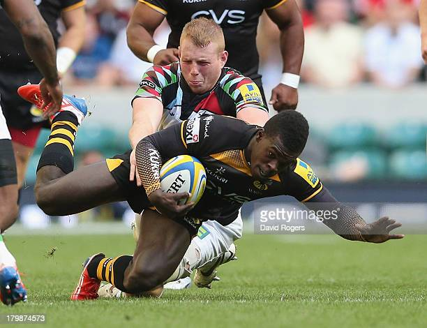 Christian Wade of Wasps is held by George Merrick during the Aviva Premiership match between London Wasps and Harlequins at Twickenham Stadium on...
