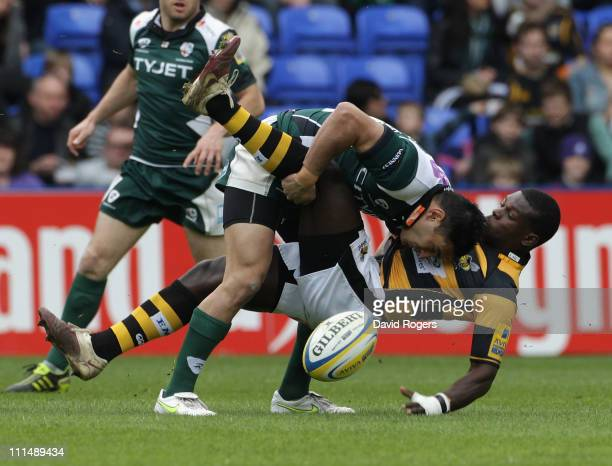 Christian Wade of Wasps is tackled by Daniel Bowden during the Aviva Premiership match between London Irish and London Wasps at the Madejski Stadium...