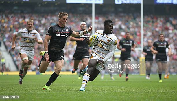 Christian Wade of Wasps races clear to score his second try during the Aviva Premiership match between Saracens and Wasps at Twickenham Stadium on...