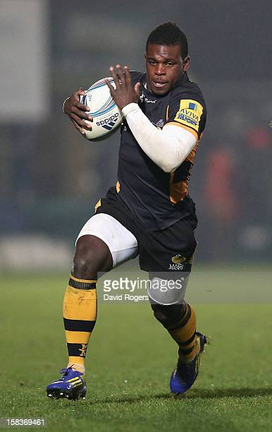 Christian Wade of Wasps runs with the ball during the Amlin Challenge Cup match between London Wasps and Bayonne at Adams Park on December 13 2012 in...