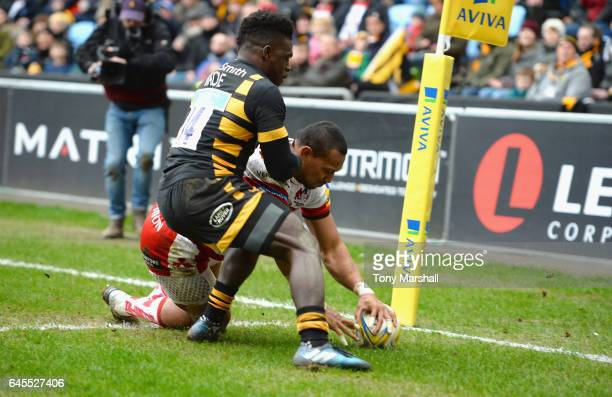 Christian Wade of Wasps tackles David Halaifonua of Gloucester Rugby as he scores a try during the Aviva Premiership match between Wasps and...