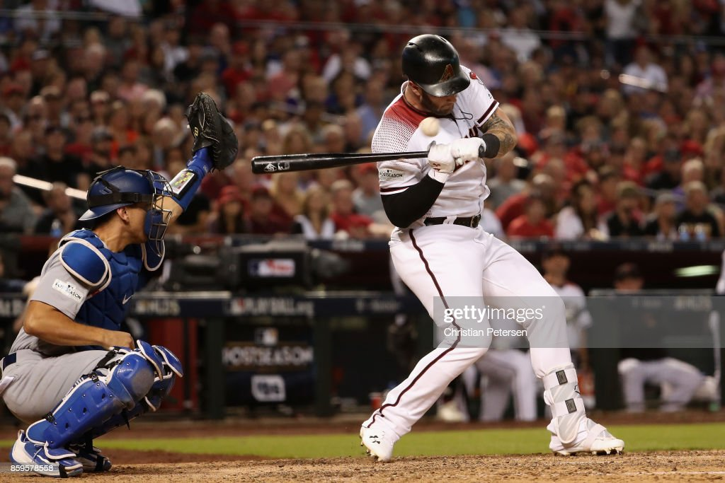 Christian Walker #53 of the Arizona Diamondbacks is hit by a pitch during the sixth inning of the National League Divisional Series game three against the Los Angeles Dodgers at Chase Field on October 9, 2017 in Phoenix, Arizona.