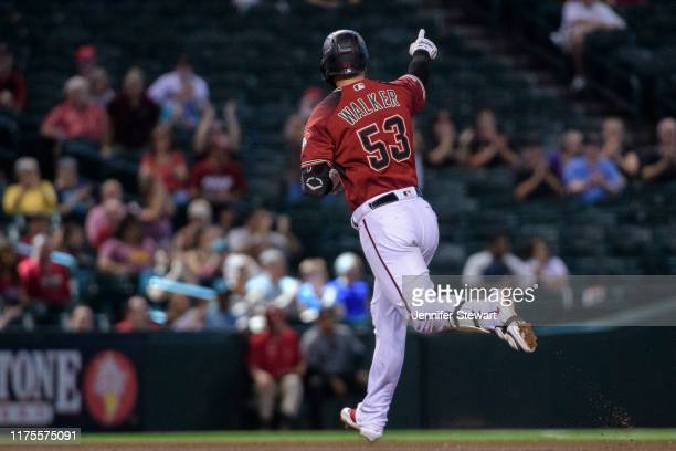 Christian Walker of the Arizona Diamondbacks points to the bullpen after hitting a solo home run in the fifth inning of the MLB game against the...