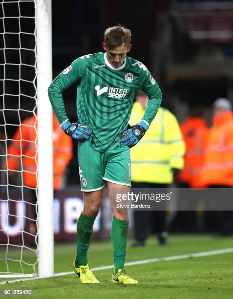 Christian Walton of Wigan Athletic looks dejected after AFC Bournemouth score their second goal during The Emirates FA Cup Third Round match between...