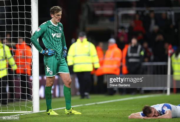 Christian Walton of Wigan Athletic reacts after AFC Bournemouth score their second goal during The Emirates FA Cup Third Round match between AFC...