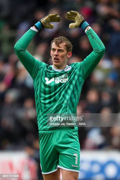 Christian Walton of Wigan Athletic reacts during The Emirates FA Cup Quarter Final match at DW Stadium on March 18 2018 in Wigan England