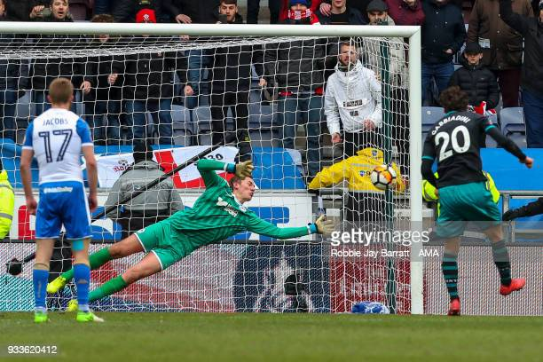 Christian Walton of Wigan Athletic saves a penalty from Manolo Gabbiadini of Southampton during The Emirates FA Cup Quarter Final match at DW Stadium...
