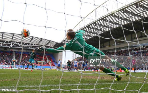 Christian Walton of Wigan Athletic saves a penalty from Manolo Gabbiadini of Southamptonduring The Emirates FA Cup Quarter Final match between Wigan...