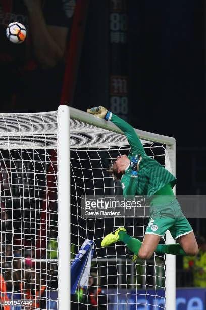 Christian Walton of Wigan Athletic tips the ball over the cross bar during the Emirates FA Cup Third Round match between AFC Bournemouth and Wigan...
