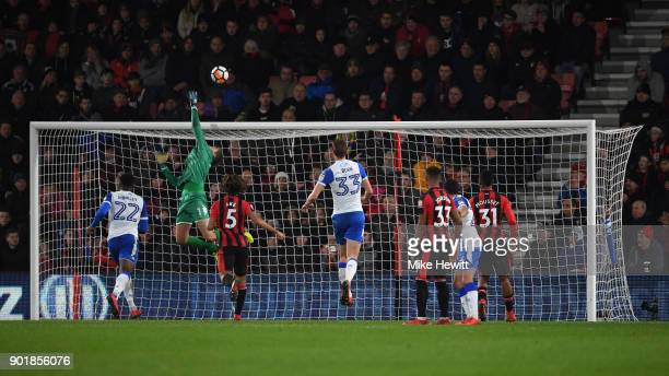 Christian Walton of Wigan saves a free kick during the The Emirates FA Cup Third Round match between AFC Bournemouth and Wigan Athletic at Vitality...