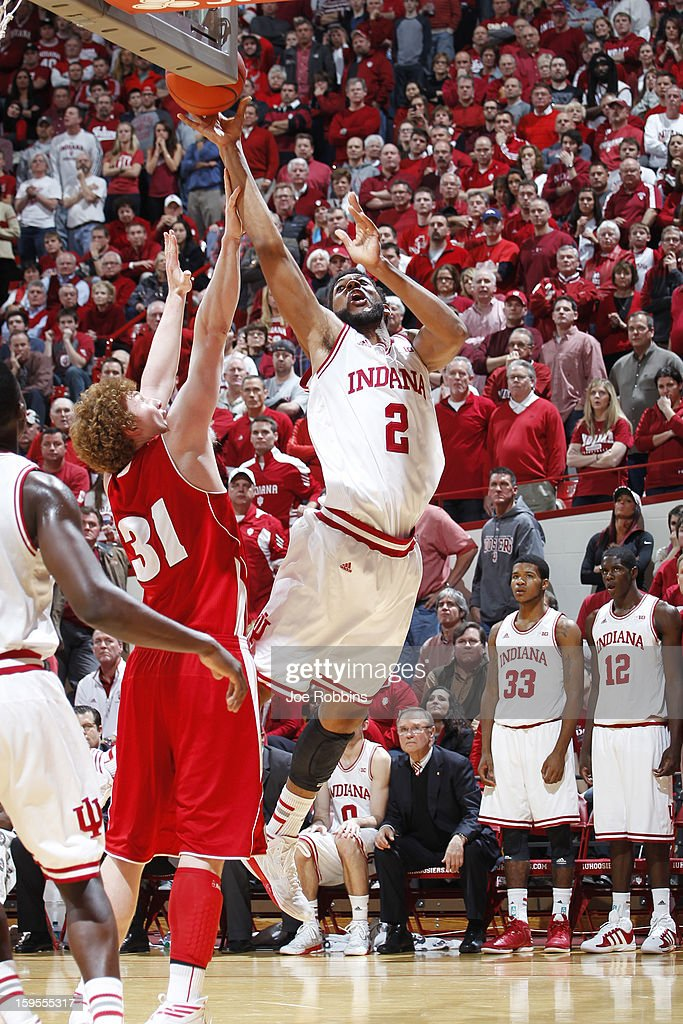 Christian Watford #2 of the Indiana Hoosiers puts up a shot against Mike Bruesewitz #31 of the Wisconsin Badgers during the game at Assembly Hall on January 15, 2013 in Bloomington, Indiana. Wisconsin defeated Indiana 64-59.