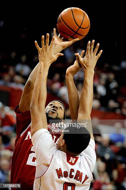 Christian Watford of the Indiana Hoosiers shots over Toney McCray of the Nebraska Cornhuskers during the first half of their game at The Devany...