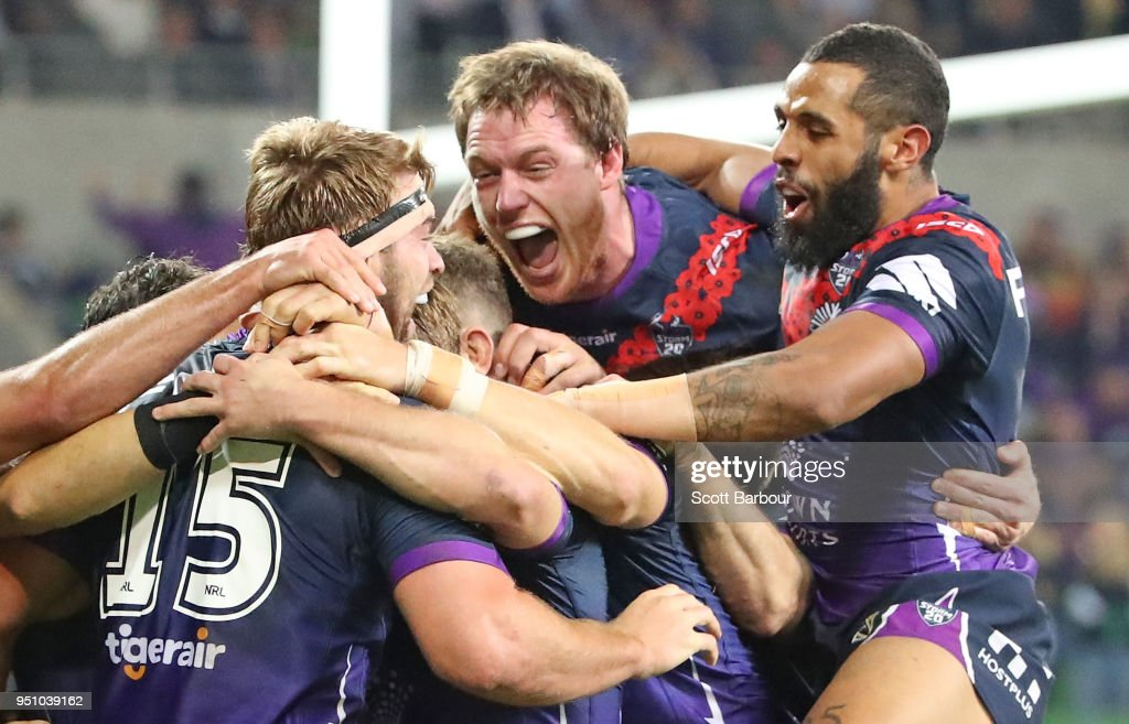 Christian Welch of the Melbourne Storm is congratulated by Josh Addo-Carr, Tim Glasby and his teammates after scoring a try during the round eight NRL match between the Melbourne Storm and New Zealand Warriors at AAMI Park on April 25, 2018 in Melbourne, Australia.