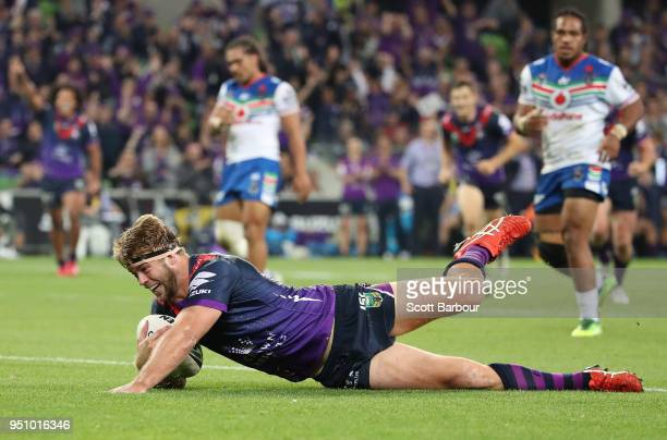 Christian Welch of the Melbourne Storm scores a try during the round eight NRL match between the Melbourne Storm and New Zealand Warriors at AAMI...