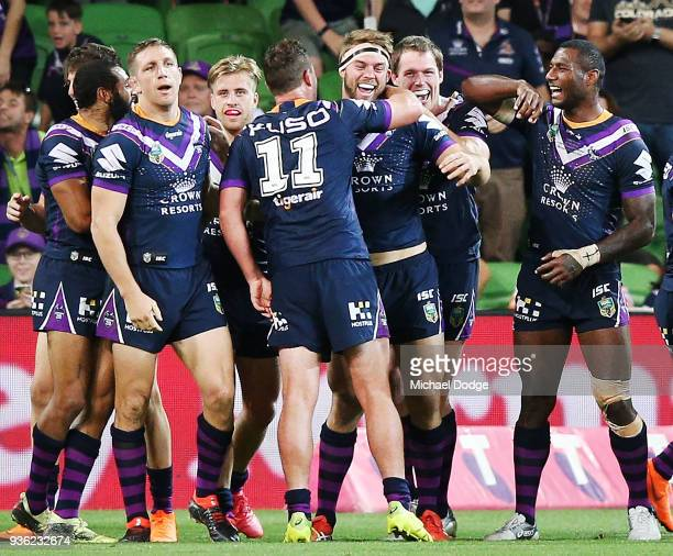 Christian Welch of the Storm celebrates a try with teammates during the round three NRL match between the Melbourne Storm and the North Queensland...