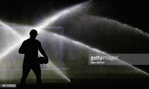 Christian Wetklo is silhouetted during day 7 of the FC Schalke 04 training camp at the ASPIRE Academy for Sports Excellence on January 12 2015 in...