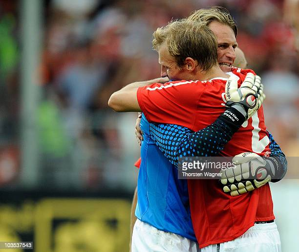 Christian Wetklo of Mainz celebrates with his team mate Bo Svenssson after winning the Bundesliga match between FSV Mainz 05 and VFB Stuttgart at...